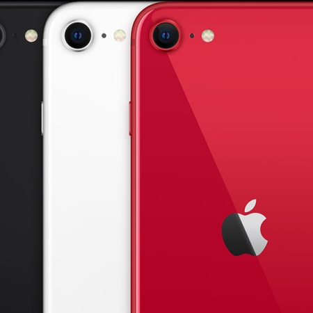 Picture of the rear of 3 new iPhone SE's. Red in the front on the far right, middle is a with iPhone, and left and rear is the black model.