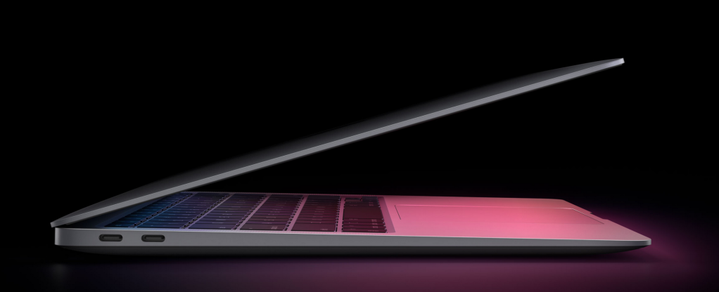 Artistic picture of MacBook Air.  Black background with red and blue highlights coming off the Air's screen.