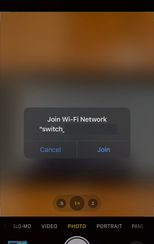"""The second banner to appear on screen asking about the wifi.  It reads """"join Wi-Fi Network """"switch_..."""" with the rest of the text blurred out."""