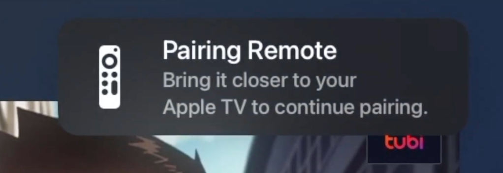 """The Apple TV Pairing Remote Prompt.  The text reads """"Pairing Remote.  Bring it closer to your Apple TV to continue pairing."""""""
