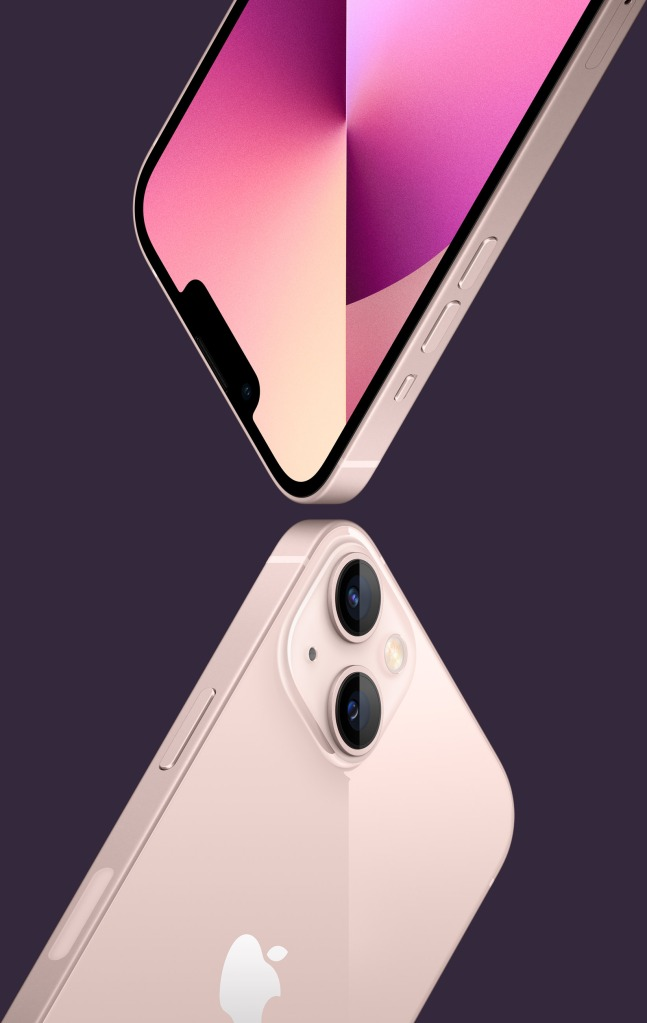 The rear face of the pink iPhone 13 underneath the front face of the same color and model iPhone (IMAGE COURTESY OF APPLE)